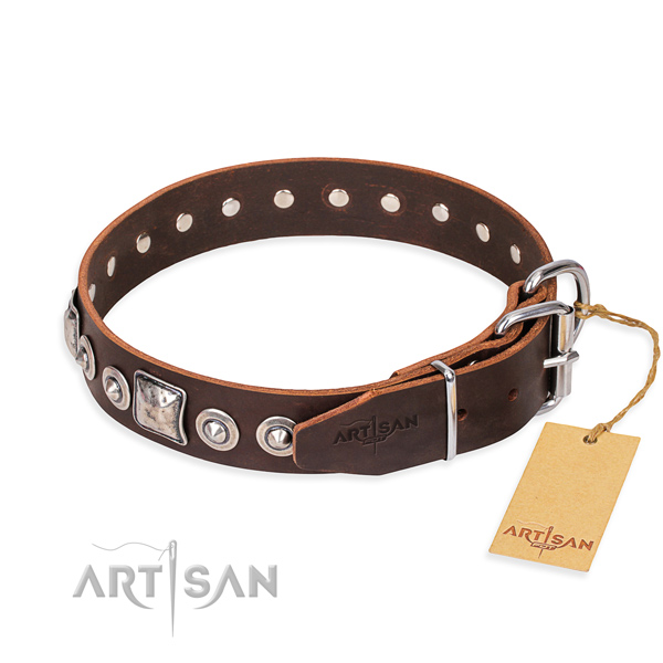 Leather dog collar made of soft to touch material with strong decorations